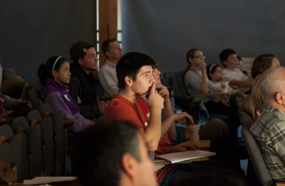 A student listens intently at the last Science Café in November. (Photo courtesy of Open Labs)