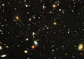 This Hubble Ultra Deep Field image reveals a random sample of nearly 10,000 galaxies, including some of the most distant ever found. It was combined from 800 separate exposures with the Hubble Space Telescope Advanced Camera for Surveys over the course of 400 Hubble orbits around Earth, in the period Sept. 24, 2003 and Jan. 16, 2004. (Credit: NASA, ESA, and S. Beckwith [STScI] and the HUDF Team)